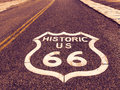 Historic US Route 66 highway sign on asphalt in Oatman, Arizona, United States. The picture was made during a motorcycle road trip