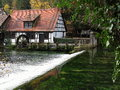 Historic water powered hammer mill at karstic spring Royalty Free Stock Photo