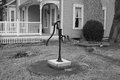 Historic water well hand pump Royalty Free Stock Photo