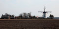 Historic windmill, part of agricultural landscape Royalty Free Stock Photo
