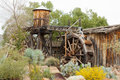 Historic wooden water mill building desert garden Royalty Free Stock Photo