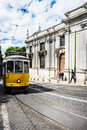 Historic yellow tram in front of the saint antony cathedral lisbon portugal april lisbon portugal Stock Photos
