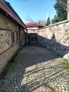 Historical building, pathway , stone paved road Royalty Free Stock Photo