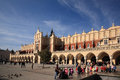 Historical cloth hall also know as renaissance sukiennice facing main square krakow poland full tourists enjoying autumnal day Stock Image