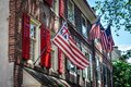 Historical Flags on a Old City building in Elfreth`s Alley Royalty Free Stock Photo