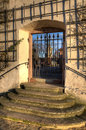 Historical gate ancient wall beautiful late afternoon light on an and old wrought iron in seligenstadt germany Stock Photography