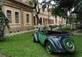 Historical Hostel and Old Car Royalty Free Stock Photos