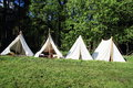 Historical tents on a meadow Stock Images