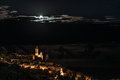 The historical town of Cervo glowing in the night under moonlight and starry sky on the coastline of Ligurian Riviera, famous trav Royalty Free Stock Photo