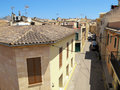 Historical town part of alcudia mallorca spain june cars parking along at typical houses old Stock Photo