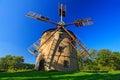 Historical windmill Svetlik near town Krasna Lipa, Czech Republic. Beautiful landscape with windmill and dark blue sky. Green tree Royalty Free Stock Photo