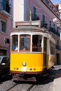 Historical yellow tram in Lisbon Stock Photography