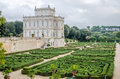 Historically an important architectural building landmark castle with garden and flowers and shrubs ladshaftnym design in the for Royalty Free Stock Photography