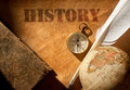 History etched on an old paper scroll with a feather quill and compass Royalty Free Stock Photography