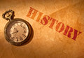 History etched on an old paper scroll with a vintage clock Royalty Free Stock Photos