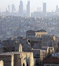 History meets nowadays ancient ruins of theodora byzantine wall in istanbul and modern skyline buildings on background at soft Stock Photography