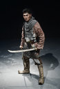 History warrior standing with two swords foto in studio Stock Image