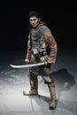 History warrior standing with two swords foto in studio Stock Image