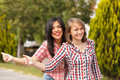 Hitch hiking girls teen in town Stock Images