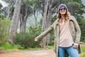 Hitch hiking woman with sunglasses Royalty Free Stock Photo