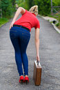 Hitchhiker with suitcase Royalty Free Stock Photo