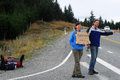 Hitchhiking in new zealand lake tekapo nz march young couple are south island of on march is one of the safest places Royalty Free Stock Images