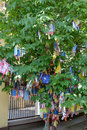 Hiymorin, color Buddhist tags with a prayer hang on a tree Royalty Free Stock Photo
