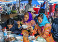 Hmong people eating on sunday market bac ha vietnam circa march men and women in traditional dress Royalty Free Stock Photography