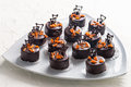 Hnadmade chocolate bonbons handmade topped with candied orange and piped for a luxury celebration Stock Photos