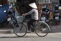 HO CHI MINH CITY, VIETNAM-NOV 3RD: A woman cycles down a street Royalty Free Stock Photo
