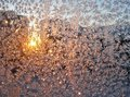 Hoar-frost on pane at sunset - winter background Royalty Free Stock Photo
