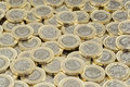 Hoard of money. Scattered pile of British pound coins. Royalty Free Stock Photo