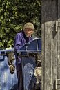 Hoarder grandfather looking in the trash useful things Royalty Free Stock Photo