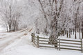 Hoarfrost road dirt and fence with trees covered in Royalty Free Stock Photos