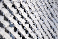 Hoarfrost winter on the braided iron fence Stock Photos