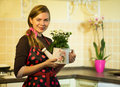 Hobby happy young housewife taking care of the flowers Stock Photography