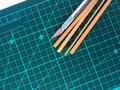 Hobby knife and cutting mat shows RC building Royalty Free Stock Photo