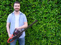 Hobbyist gardner using an hedge clipper in the home garden Royalty Free Stock Photo