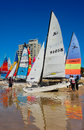 Hobie sas nationals port elizabeth colourful sails line the shore at beach during the sailing held in south africa from Royalty Free Stock Photo