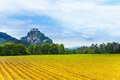 Hochosterwitz castle and fields in austria rural agriculture front of it at spring Stock Image