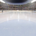 Hockey arena with fans in the stands and copy space on ice low angle view of full of deliberate focus on foreground ice shallow Royalty Free Stock Image