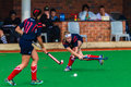 Hockey girls passing ball girl to team player from mpumalanga province at the south african high schools national championships Stock Photos