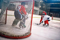 Hockey goals, shoots the puck and attacks goalkeeper Royalty Free Stock Photo
