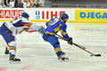Hockey player holding opponent by the stick during world cup match between teams of romania and ukraine division i Stock Photo