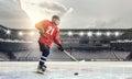 Hockey player on ice . Mixed media Royalty Free Stock Photo