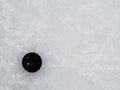 Hockey puck on ice Royalty Free Stock Photo