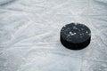 Hockey puck on ice hockey rink Royalty Free Stock Photo