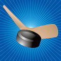 Hockey puck and stick on blue starburst Royalty Free Stock Photos