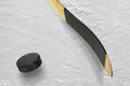 Hockey puck and stick on the ice Royalty Free Stock Photo