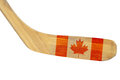 Hockey stick with the image of the canadian flag isolated Stock Photography